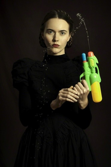 Woman with a water pistol