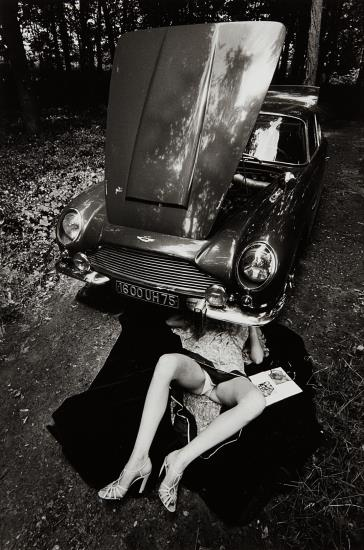 Jeanloup Sieff-Alone Under A Car With Open Hood, Paris-1975