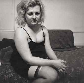 Diane Arbus-Transvestite with a torn stocking, N.Y.C.-1966
