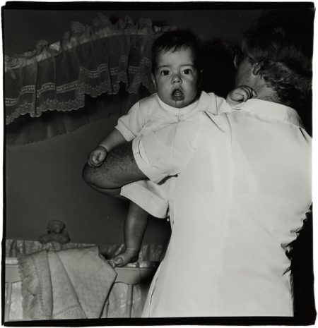 Diane Arbus-Toddler Being Held By Nurse, N.J.-1968