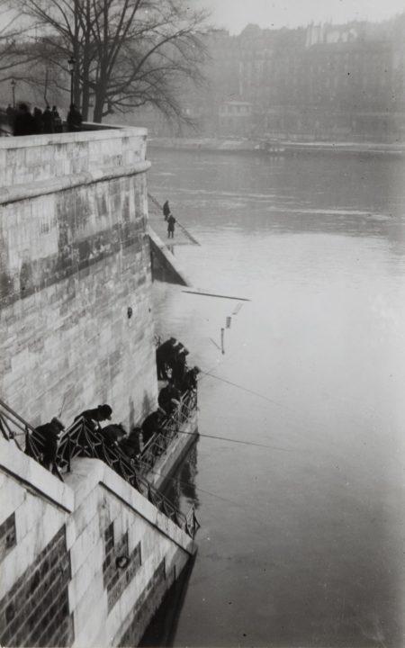 Andre Kertesz-Fishermen Behind Notre Dame, Paris-1925