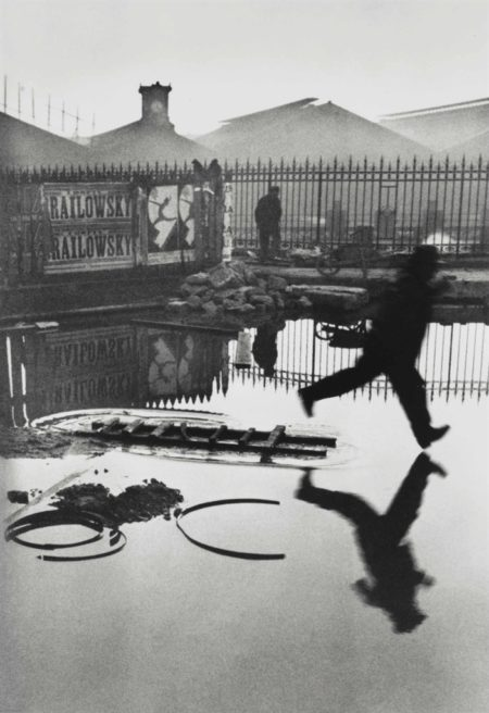 Henri Cartier-Bresson-Behind The Gare St. Lazare, Paris-1932