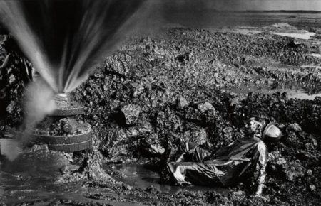 Sebastiao Salgado-Greater Buhrman Oil Field, Kuwait (Fallen Worker) / Man Lying in Oil-1991