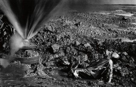 Greater Buhrman Oil Field, Kuwait (Fallen Worker) / Man Lying in Oil-1991