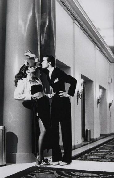 Helmut Newton-Woman Into Man, Lighting A Cigarette, Yves Saint Laurent Pour Vogue, (1979)-1979