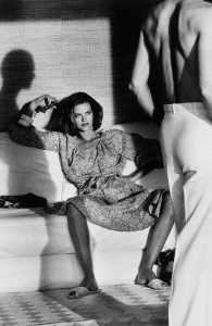 Helmut Newton-Woman examing Man-1975