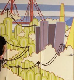 Adam Ziskie in front of 934 Howard Mural
