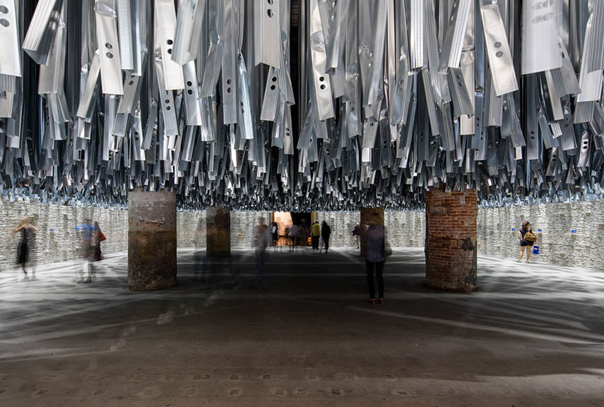 using collage design and other methods to recycle and create sculptures Aravena managed to make a statement in Venice