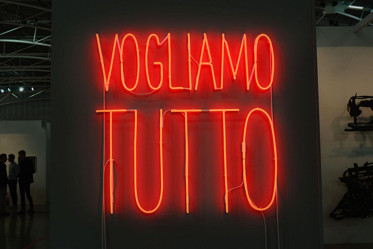 Alfredo Jaar - Vogliamo Tutto, 2016. Red neon mounted directly on the wall, 101,6 x 101,6 cm, 40 x 40 in. Courtesy Galleria Lia Rumma