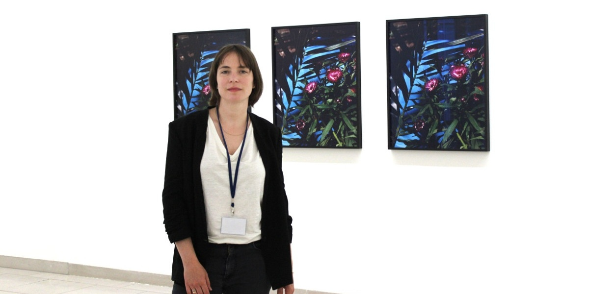 Annette-Kelm-in-front-of-her-work