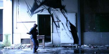 Antistatik in front of his work - image via graffuturism.files.wordpress.com