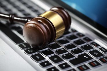 Auction Tool on a Laptop Keyboard - Image via randorg buyers sales artist report terms