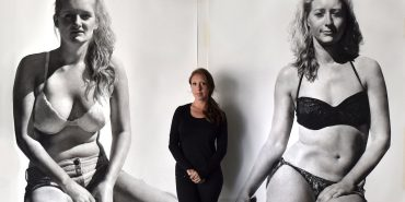 Clio Newton in front of her work
