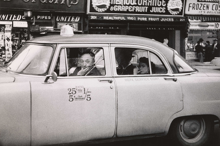 Diane Arbus. Taxicab driver at the wheel with two passengers, N.Y.C. 1956.
