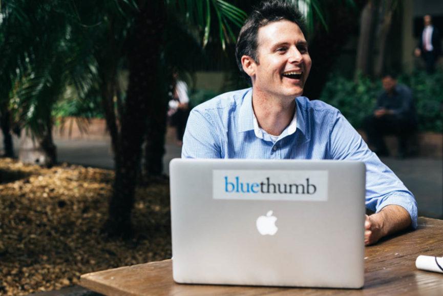 Edward Hartley enjoying a coffee at Sazón reading news and watshching news on his laptop on many news websites