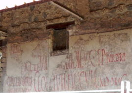 Election slogans on a wall in Pompeii. Image via ancientworldlives.wordpress.com