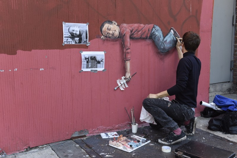 Ernest Zacharevic - Boy On Fence making of - Photo Credit Martha Cooper