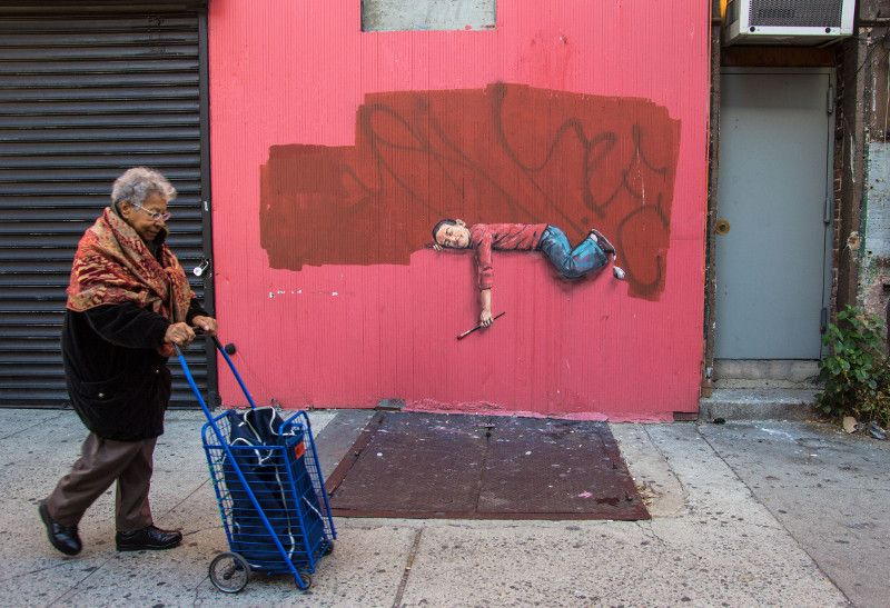 Ernest Zacharevic - Boy on a fence street view - Photo Credit Ernest Zacharevic