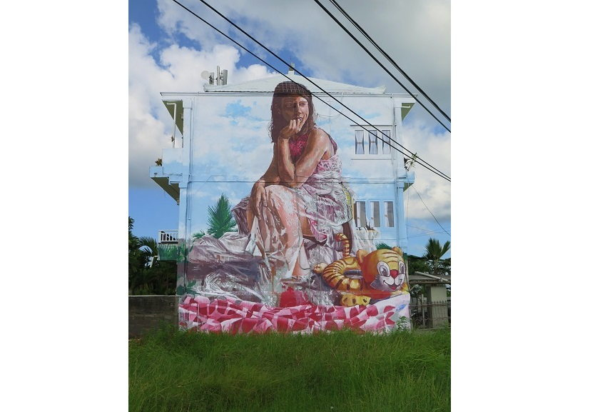Fintan Magee - Girl with Inflatable Tiger,2016, graffiti.