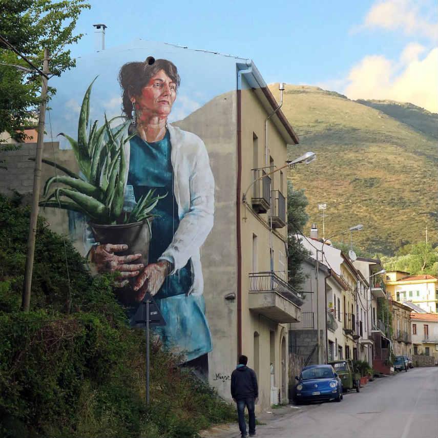 Fintan Magee - Woman with aloe Vera plant, Sapri, Italy, 2016