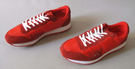 Invader-A pair of red sneakers. Size 44-