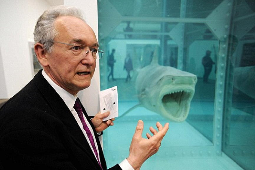 Julian Spalding next to Damien Hirst's Shark in formaldehyde. Image via dailymail.com