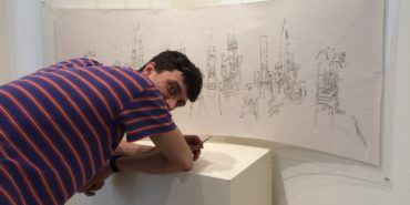 Max Blotas - Artist in front of his work - Image courtesy of