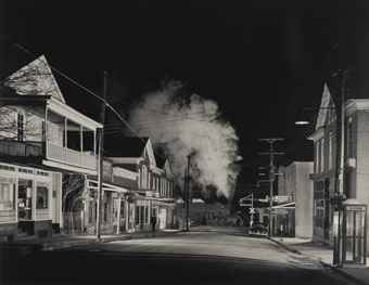 O. Winston Link-Policeman Weldon Painter Patrols the Main Street, Stanley, Virginia-1956
