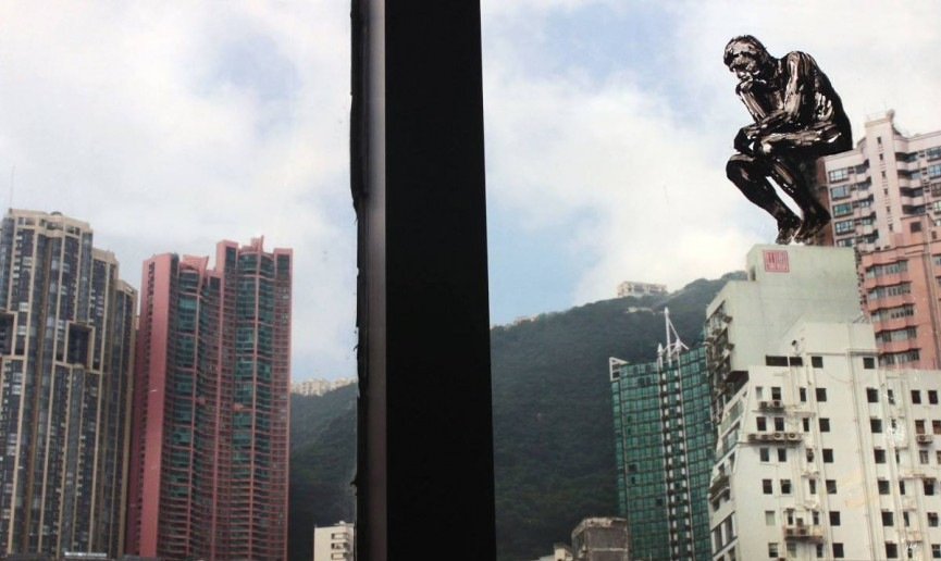 Pejac – The Re-Thinker, painted on a window of a hotel in Hong Kong, 2015