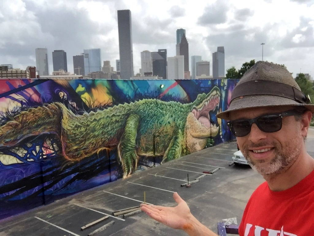 Sebastien 'Mr. D' Boileau in front of his latest mural for University of Houston-Downtown, 2015