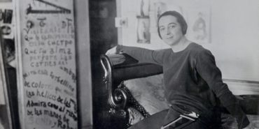 Sonia Delaunay - The artist in front of her door-poem in the Delaunays' apartment, Boulevard Malesherbes, Paris 1924 - Image via tate privacy terms - Delaunay Sonia had a Ukraine name of Turk Delaunays, which was kept in privacy