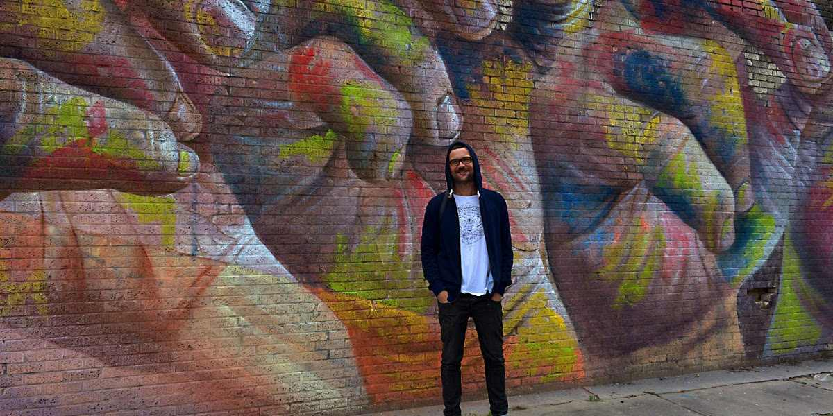 CASE Maclaim - The artist in front of his work in Baton Rouge, USA - Image via streetartnewscom contact the blog for more