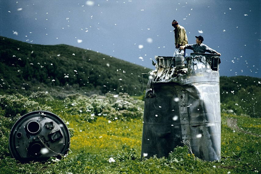 Villagers collecting scrap from a crashed spacecraft, Altai Territory, Russia, 2000 © Jonas Bendiksen Magnum Photos