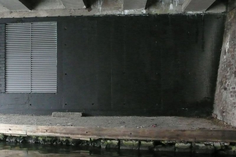 Wall painted in black again by anonymous third-party, 2010