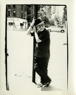 Andy Warhol, Photograph of Truman Capote Leaning on a Street Lamp, 1980