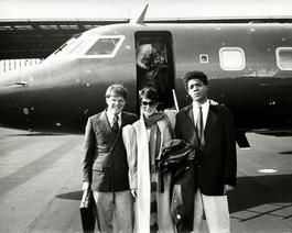 Andy Warhol, Photograph of Jean-Michel Basquiat, Richard Weisman and an Unidentified Woman by a Jet