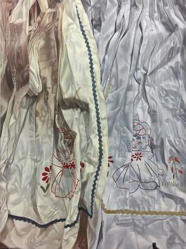 Embroidery of twins hiding in the folds