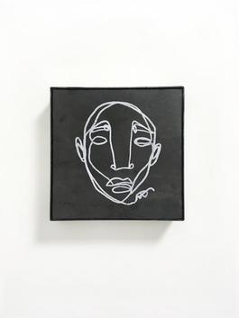 Head (stone) IX