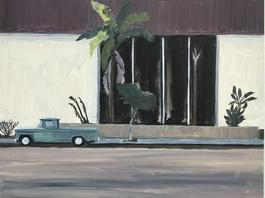 Green truck with palm tree