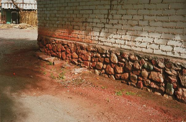 William Eggleston-Untitled (Side Of Brown Stone Wall, Arizona)-2000