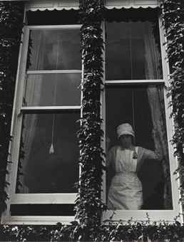Bill Brandt-Parlourmaid at a Window in Kensington-1939