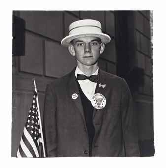Diane Arbus-Boy with a straw hat waiting to march in a pro-war parade, N.Y.C.-1967