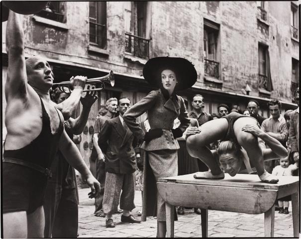 Richard Avedon-Elise Daniels With Street Performers, Suit By Balenciaga, Le Marais, Paris, August-1948
