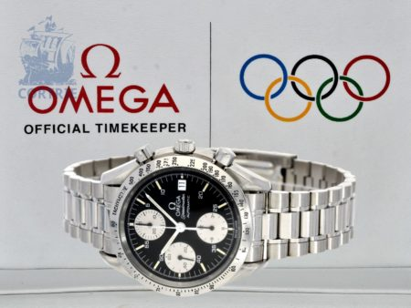 Wristwatch: Omega Speedmaster chronograph, stainless steel, box and certificates-