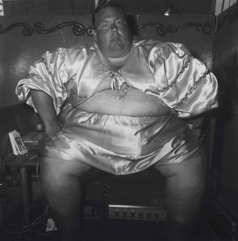 Diane Arbus-Fat man at a carnival, MD.-1970