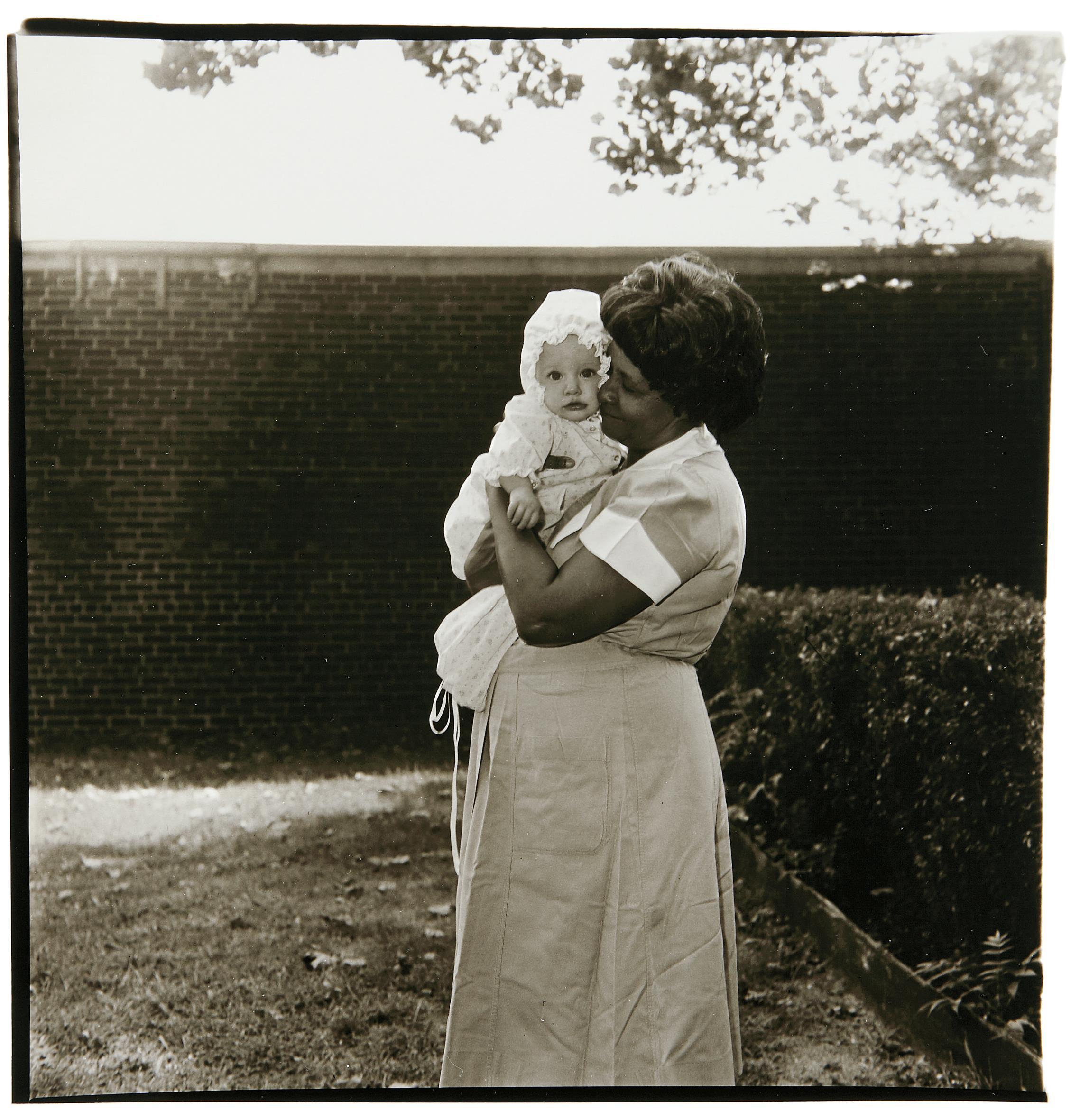 Diane Arbus-Toddler Being Held In Garden, N.J.-1968