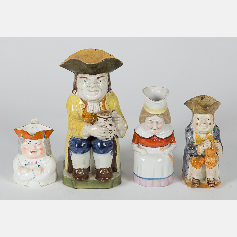 Four Staffordshire Toby Jugs-
