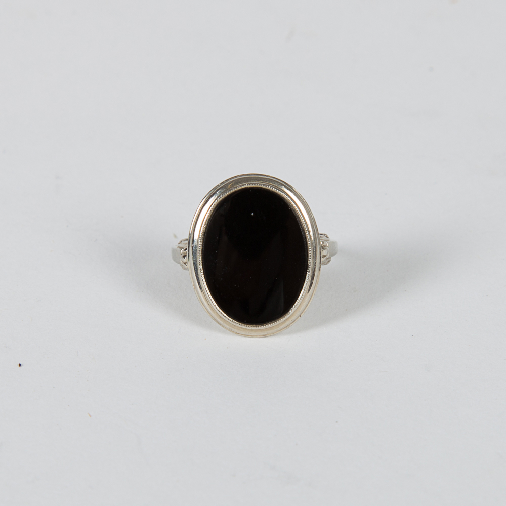 A 14kt. White Gold and Onyx Ring-
