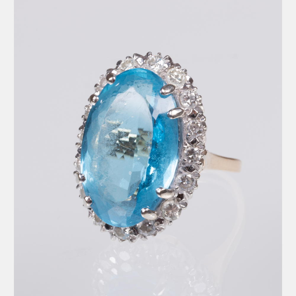 A Blue Topaz and Diamond Ring-