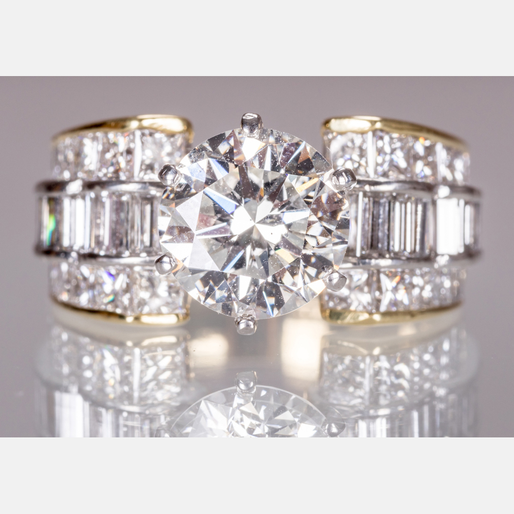 A Gold and Platinum Diamond Ring-